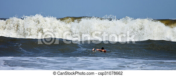 huge wave and surfer - csp31078662