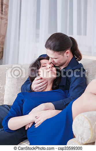 hugs pregnant couple - csp33599300