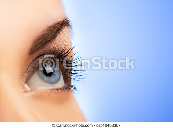 Human eye on blue background (shallow DoF) - csp10403387
