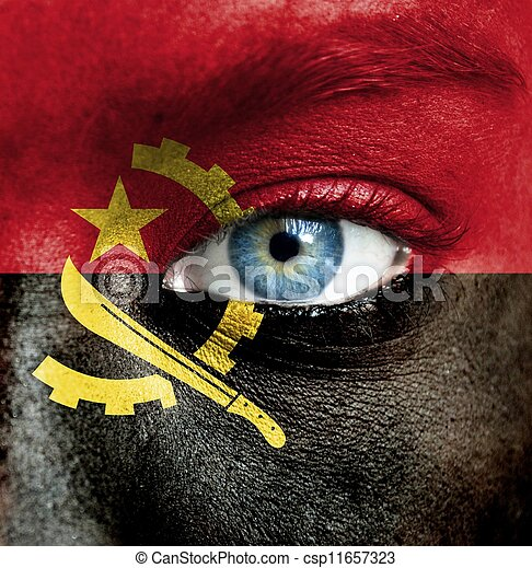 Human face painted with flag of Angola - csp11657323