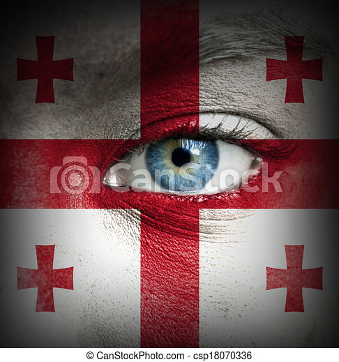 Human face painted with flag of Georgia - csp18070336