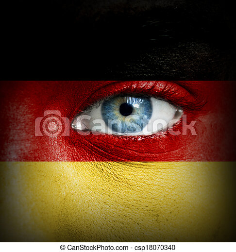 Human face painted with flag of Germany - csp18070340