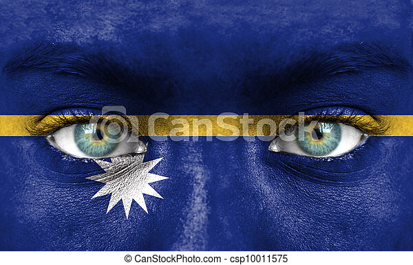 Human face painted with flag of Nauru - csp10011575