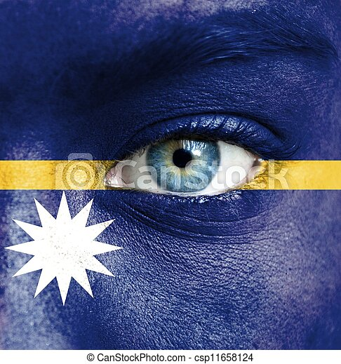 Human face painted with flag of Nauru - csp11658124