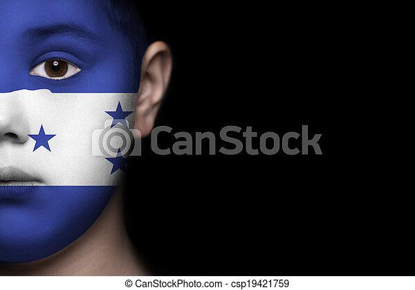 Human face with flag of Honduras - csp19421759