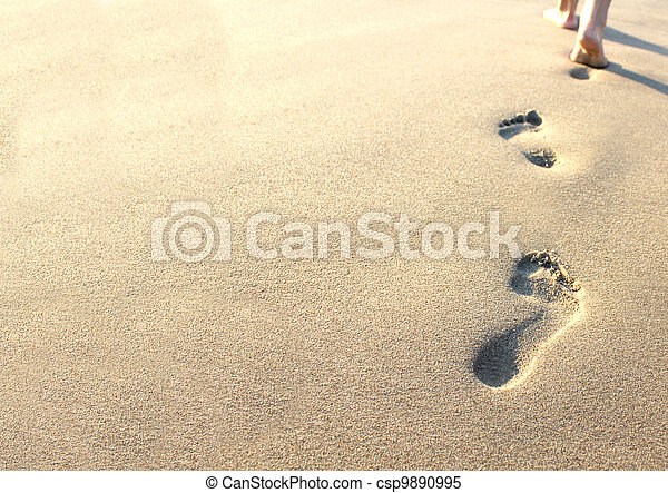 human footprints in the sand  - csp9890995