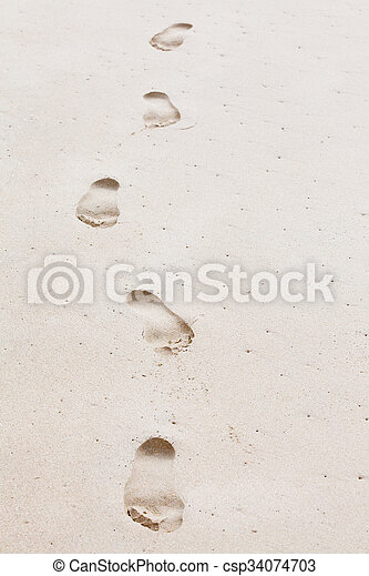 Human footprints leading towards the viewer. Copyspace on right - csp34074703