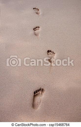 human footprints on the beach sand - csp15468764