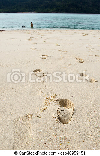 human footprints on the beach sand - csp40959151