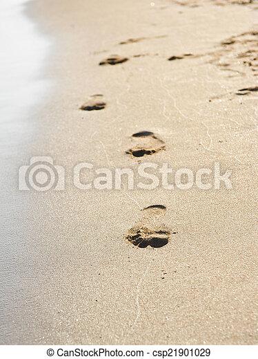 Human footprints on the beach sand - csp21901029