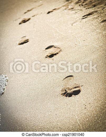 Human footprints on the beach sand - csp21901040