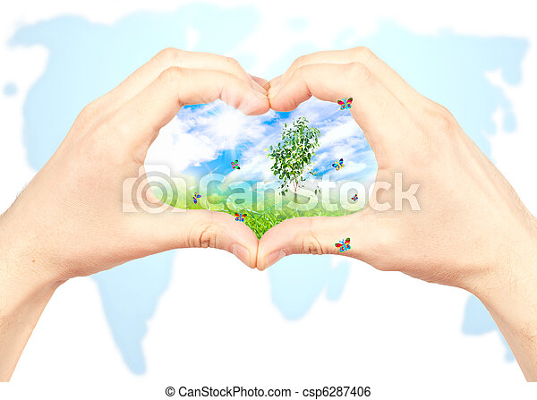 Human hand and nature on world map background symbol of the human hand and nature on world map background stock photo gumiabroncs Images