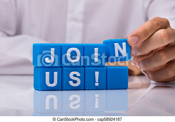 Human Hand Building Blue Cubic Blocks With Join Us Text - csp58924187