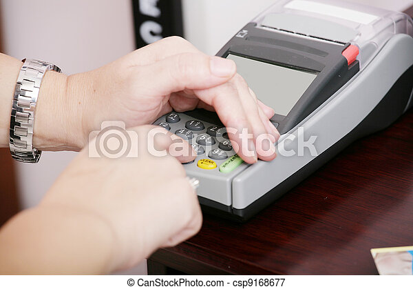 Human hand enter atm banking cash machine pin code - csp9168677