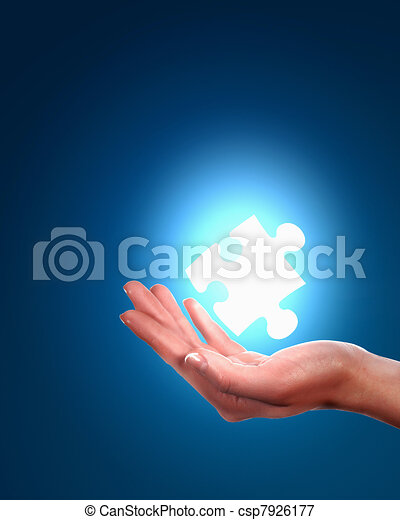 human hand with a piece of puzzle - csp7926177