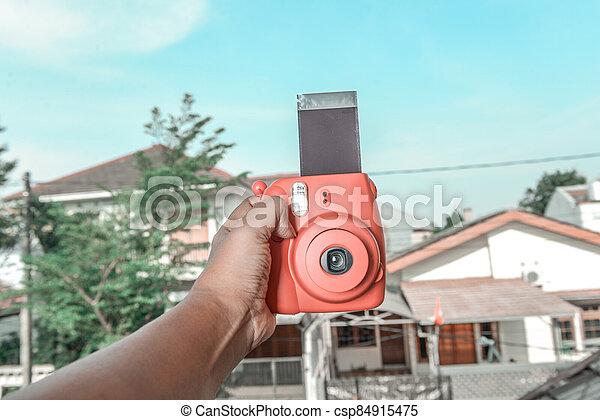 Human hands holding a camera - csp84915475