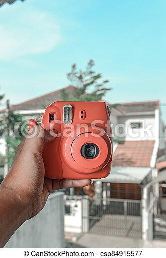 Human hands holding a camera - csp84915577