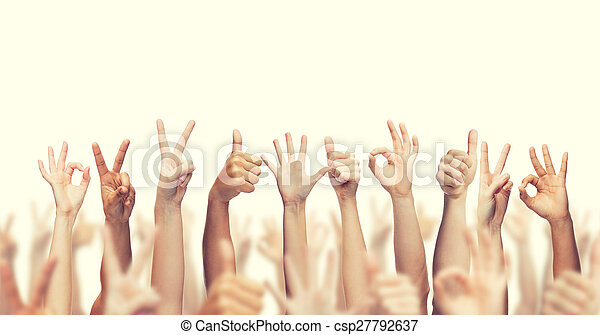 human hands showing thumbs up, ok and peace signs - csp27792637