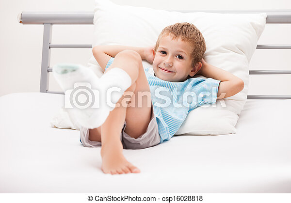 Human healthcare and medicine concept - little child boy with plaster bandage on leg heel fracture or broken foot bone - csp16028818