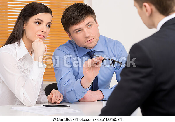 Human resources agency doing interview. Blur candidate on foreground  - csp16649574
