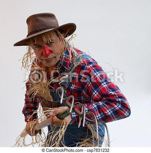 Human scarecrow scaring birds - csp7831232