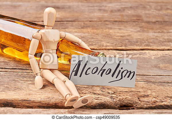 Human wooden dummy and alcohol. - csp49009535