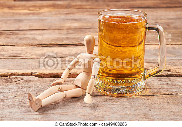 Human wooden dummy and beer. - csp49403286