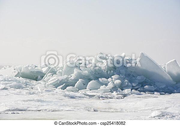 Hummock on the frozen sea shore at spring season - csp25418082