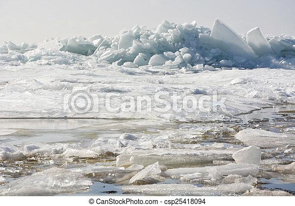Hummock on the frozen sea shore at spring season - csp25418094