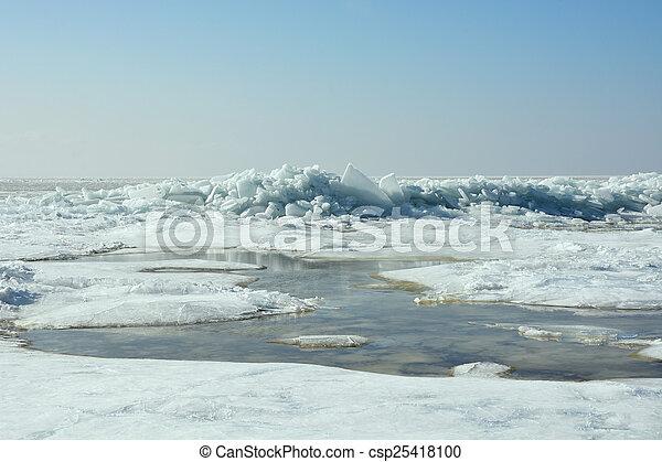 Hummock on the frozen sea shore at spring season - csp25418100