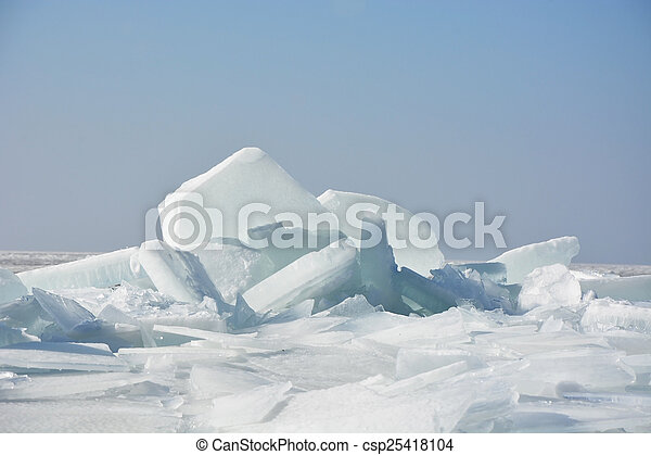 Hummock on the frozen sea shore at spring season - csp25418104