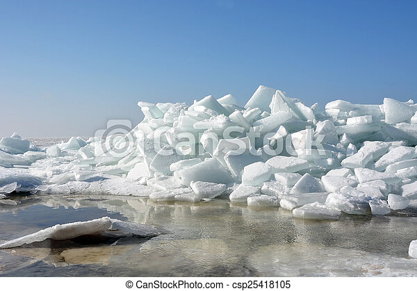 Hummock on the frozen sea shore at spring season - csp25418105