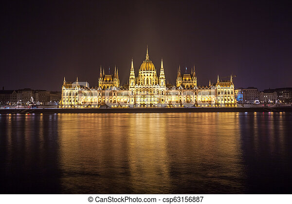 Hungarian Parliament Building on the bank of the Danube in Budapest at night - csp63156887