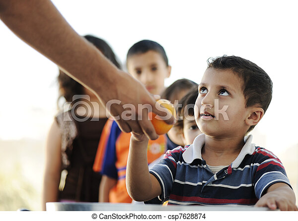 Hungry children in refugee camp, distribution of humanitarian food - csp7628874