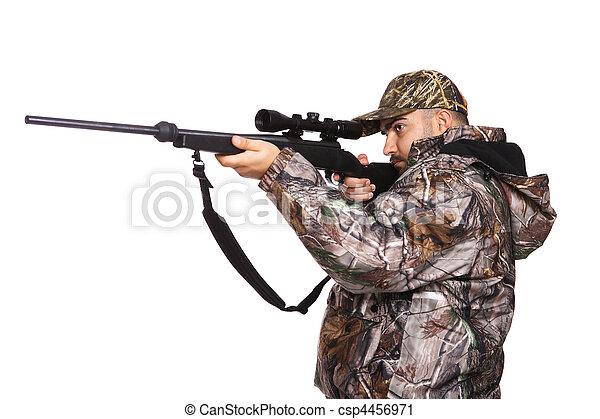 Hunter aiming a rifle - csp4456971