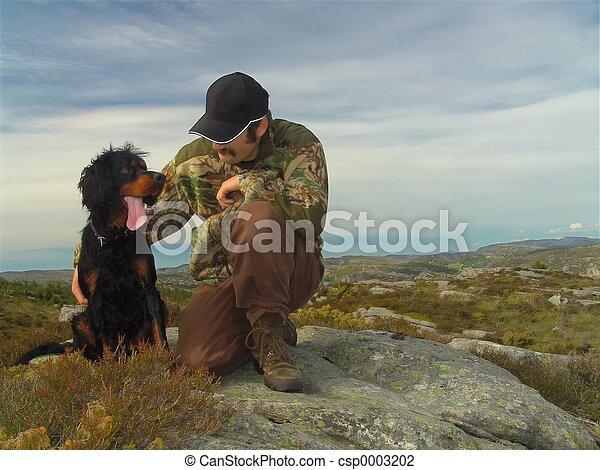 Hunter and his dog - csp0003202