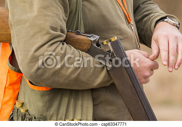 Hunter hunting in beautiful nature close up picture - csp63347771