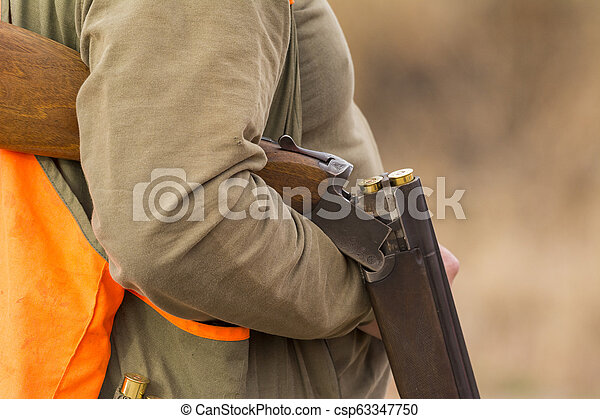 Hunter hunting in beautiful nature close up picture - csp63347750
