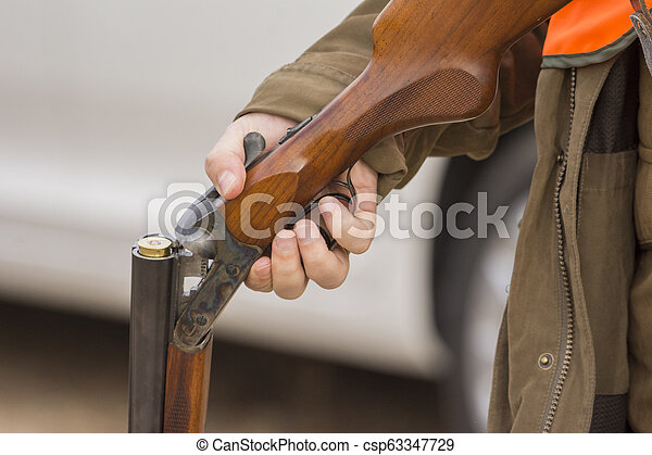 Hunter hunting in beautiful nature close up picture - csp63347729