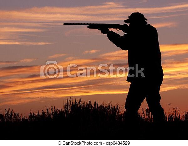 Hunter in Sunset With Shotgun - csp6434529