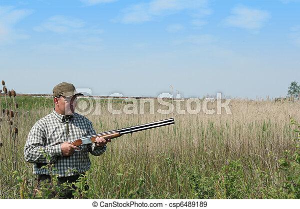hunter waiting for wild ducks - csp6489189