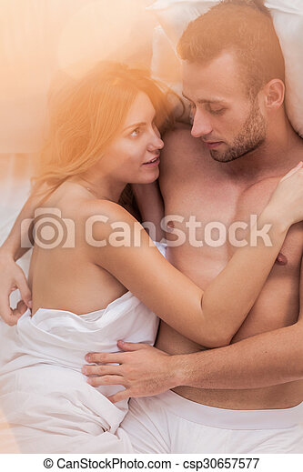 Husband And Wife In Bed Husband And Wife Lying In Bed Embracing