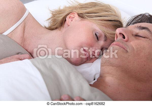 Husband and wife sleeping - csp8162682