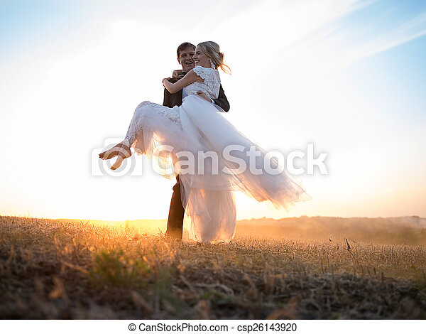 Husband carries his beloved wife in arms - csp26143920