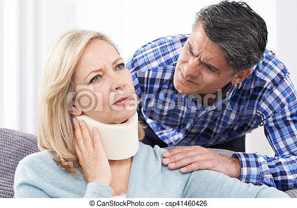 Husband Comforting Husband Suffering With Neck Injury - csp41460426