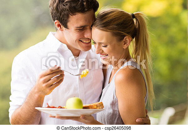 husband feeding wife breakfast - csp26405098