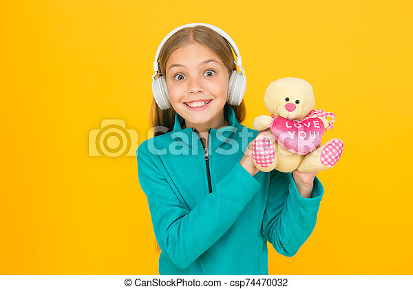 I love you with all my heart. Happy girl celebrate love. Little child wear earphones with teddy bear. Love you inscription. Spread love all over you go. Happy valentines day. Holiday celebration - csp74470032