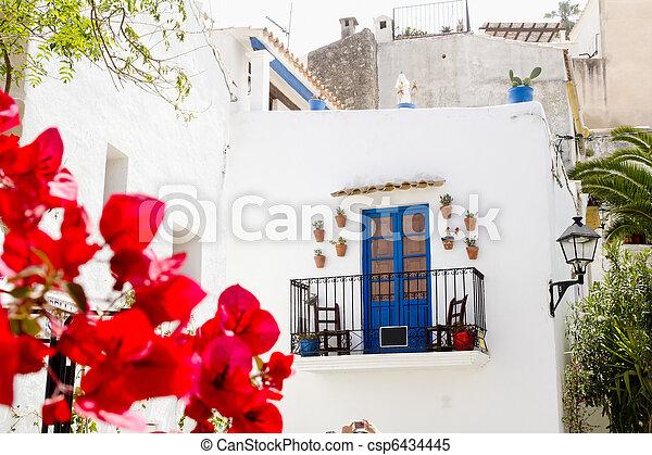 Ibiza white island architecture corner bougainvilleas - csp6434445