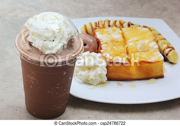 ice chocolate and toast topped with honey - csp24786722