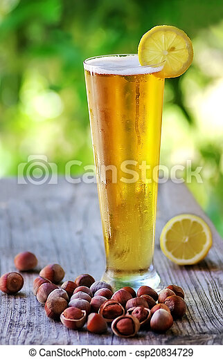 Ice cold beer and lemon and hazelnuts - csp20834729